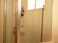 A Beautiful Example of a Semi-Framed Shower Screen by Palmers Glass